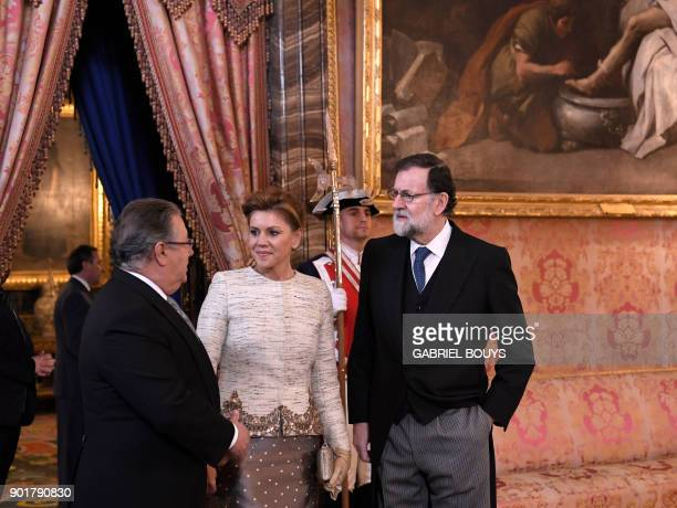 Spain's Interior Minister Juan Ignacio Zoido talks with Spanish Prime Minister Mariano Rajoy and Spain's Defence Minister Maria Dolores de Cospedal...