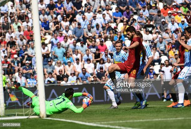 Spain's Italian goalkeeper Alex Meret catches the ball as Roma's defender from Argentina Federico Fazio tries to kick during the Italian Serie A...