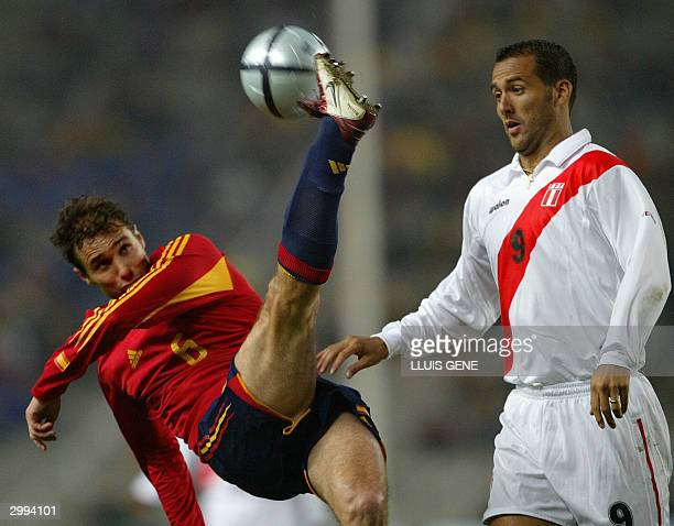 Spain's Ivan Helguera vies with Peruvian's Silva during a friendly match at Olympic Lluis Companys stadium in Barcelona 18 February 2004 AFP...