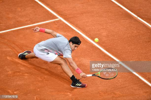 Spain's Jaume Munar plays a backhand return to Croatia's Borna Coric during their tennis match on the day 4 of the MonteCarlo ATP Masters Series...