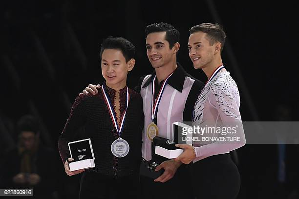 Spain's Javier Fernandez poses on the podium with second place Kazakhstan's Denis Ten and third place USA's Adam Rippon after he won the Men event at...