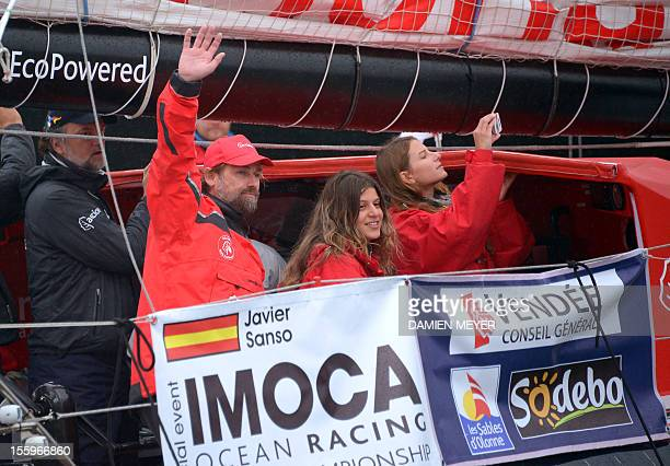 Spain's Javier Sanso on board his monohull 'Acciona' waves before the start of the 7th edition of the Vendee Globe the solo nonstop roundtheworld...
