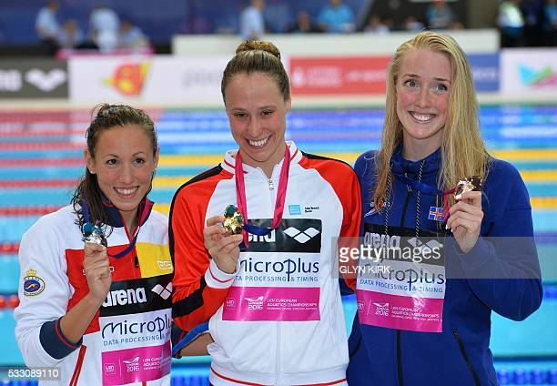 Spain's Jessica Vall Montero Denmark's Rikke Moeller Pedersen and Iceland's Hrafnhildu Luthersdttir pose for pictures with their medals after winning...