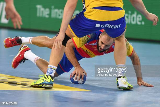 Spain's Joan Canellas falls during the final match of the Men's 2018 EHF European Handball Championship between Spain and Sweden on January 28 2018...