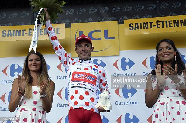 Spain's Joaquim Rodriguez celebrates his polka dot jersey of best climber on the podium at the end of the 1855 km twelfth stage of the 101st edition...