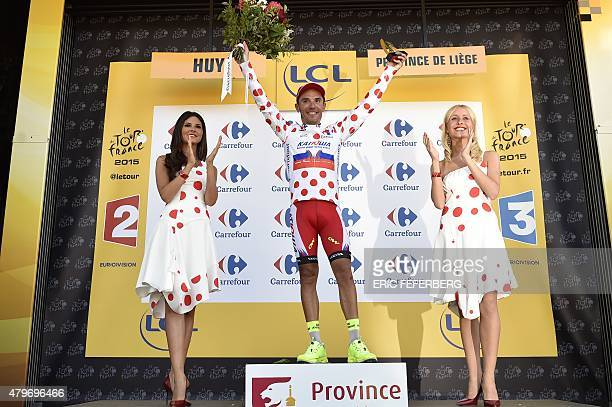 Spain's Joaquim Rodriguez celebrates his polka dot jersey of best climber on the podium at the end of the 1595 km third stage of the 102nd edition of...