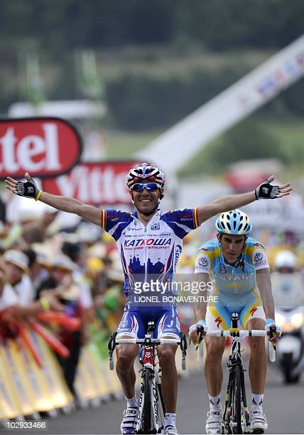 Spain's Joaquim Rodriguez celebrates on the finish line as he wins ahead of Spain's Alberto Contador the 210,5 km and 12th stage of the 2010 Tour de...