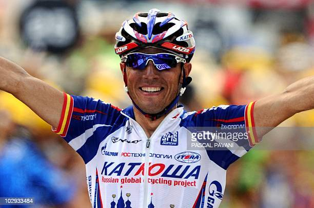 Spain's Joaquim Rodriguez celebrates on the finish line as he wins the 210,5 km and 12th stage of the 2010 Tour de France cycling race run between...