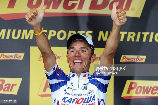 Spain's Joaquim Rodriguez celebrates on the podium after winning the 210,5 km and 12th stage of the 2010 Tour de France cycling race run between...