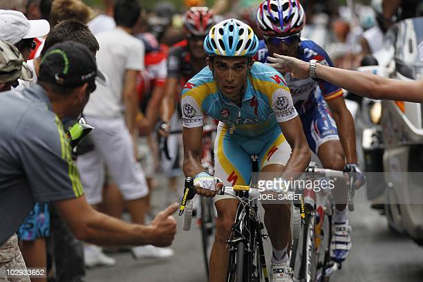 Spain's Joaquim Rodriguez rides behind Spain's Alberto Contador before winning the 210,5 km and 12th stage of the 2010 Tour de France cycling race...