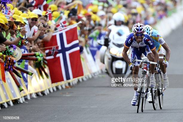 Spain's Joaquim Rodriguez sprints on the finish line as he wins ahead of Spain's Alberto Contador the 210,5 km and 12th stage of the 2010 Tour de...