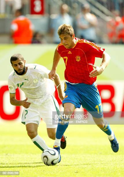 Spain's Joaquin and Saudi Arabia's Abdulaziz Khathran battle for the ball