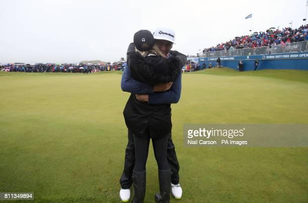 Spain's Jon Rahm celebrates winning the Dubai Duty Free Irish Open with girlfriend Kelley Cahill at Portstewart Golf Club