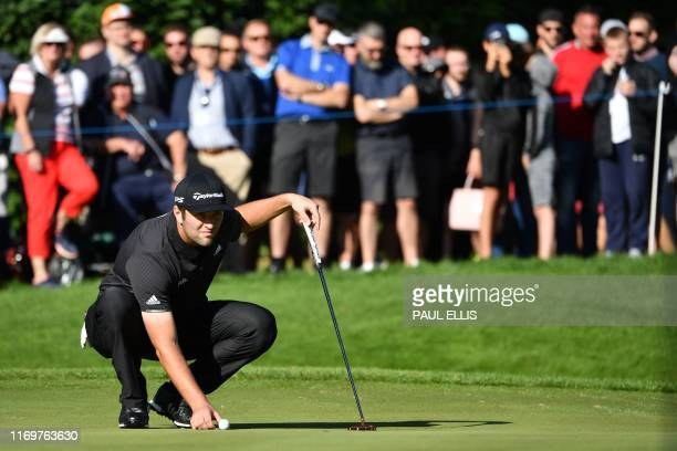 Spain's Jon Rahm putts at the 4th hole on Day 2 of the golf PGA Championship at Wentworth Golf Club in Surrey south west of London on September 20...