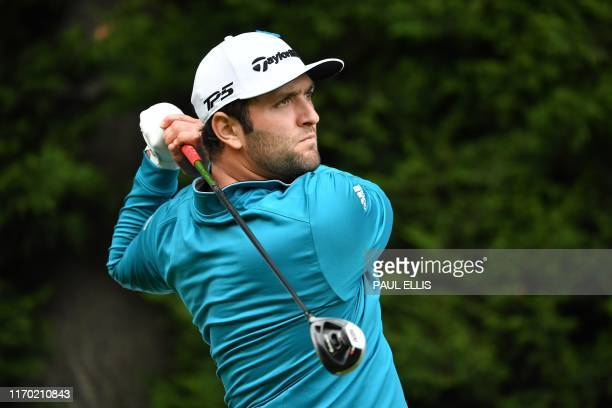 Spain's Jon Rahm watches his drive from the 18th tee on Day 4 of the golf PGA Championship at Wentworth Golf Club in Surrey south west of London on...