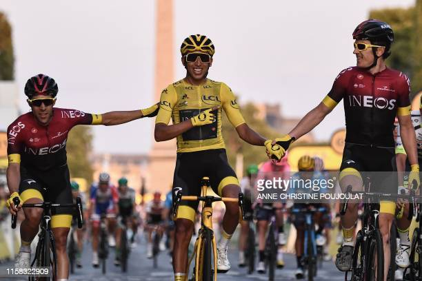 TOPSHOT Spain's Jonathan Castroviejo and Great Britain's Geraint Thomas congratulate Colombia's Egan Bernal wearing the overall leader's yellow...
