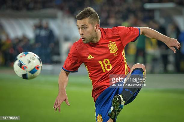 Spains Jordi Alba receives a pass during the friendly football match between Romania and Spain in Cluj Napoca Romania on March 27 2016 / AFP / ANDREI...