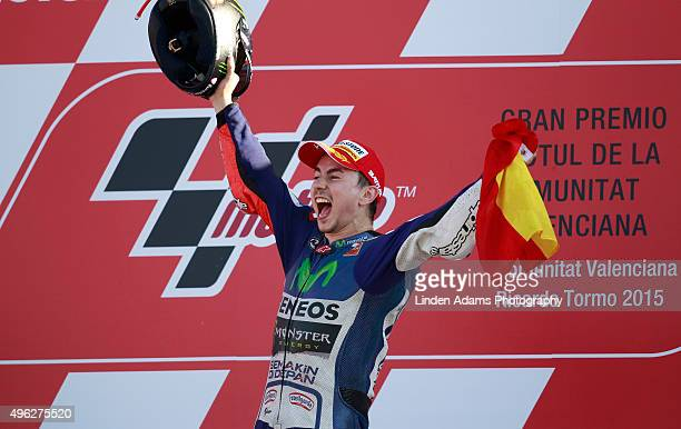 Spain's Jorge Lorenzo after beating his Moviestar Yamaha team mate Valentino Rossi to the World MotoGP title celebrates on the podium at Comunitat...