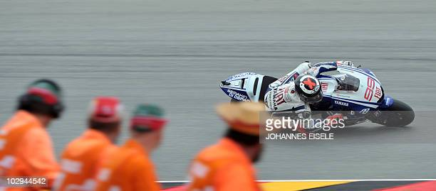 Spain's Jorge Lorenzo of the Fiat Yamaha team steers his bike during the second free practice session of the MotoGP race at the Sachsenring Circuit...