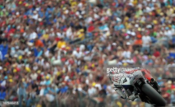Spain's Jorge Lorenzo of the Fiat Yamaha team steers his bike during the qualifying practice of the MotoGP race at the Sachsenring Circuit on July 17...