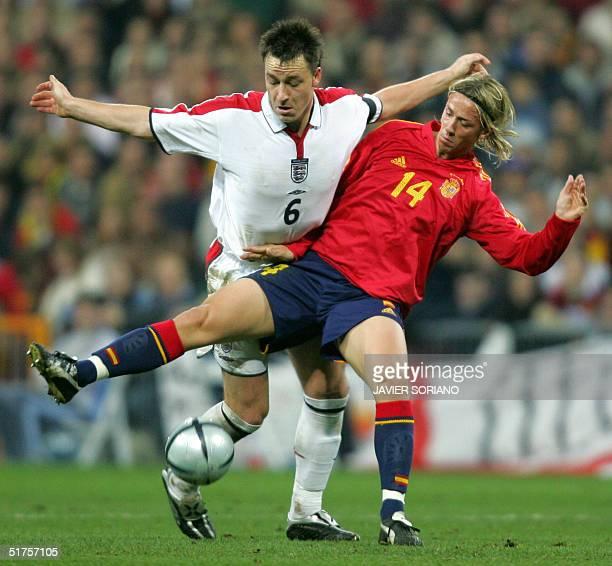 Spain's Jose Maria Gutierrez vies with England's John Terry during their football friendly international match at Santiago Bernabeu stadium in...