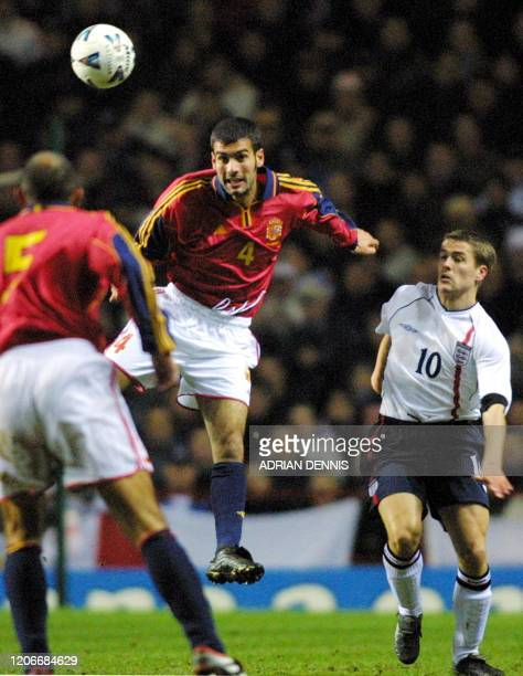 Spain's Josep Guardiola heads back to Aberlardo Fernandez while England's Michael Owen closes in during the first half of the friendly international...