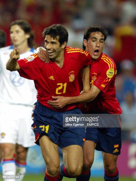 Spain's Juan Carlos Valeron celebrates scoring the opening goal against Russia with Vicente