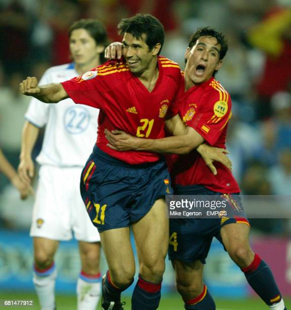 Spains Juan Carlos Valeron celebrates scoring with Vicente