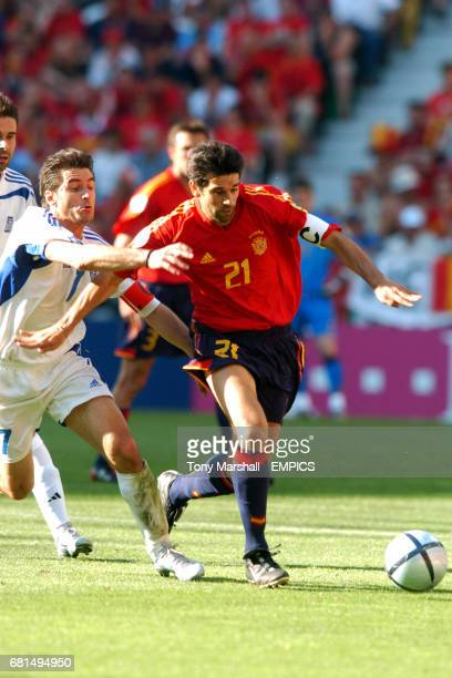 Spain's Juan Carlos Valeron goes past Greece's Theodoros Zagorakis