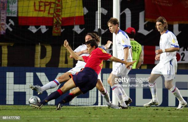 Spain's Juan Carlos Valeron scores the opening goal of the game
