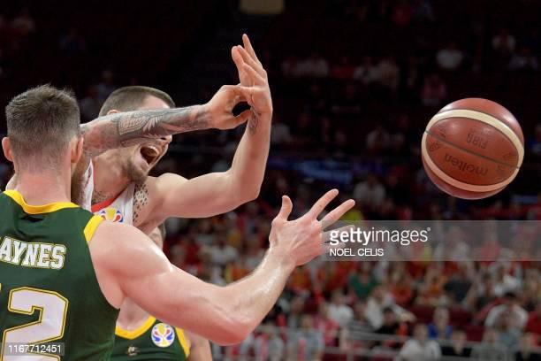 TOPSHOT Spain's Juan Hernangomez and Australia's Aron Baynes fight for the ball during the Basketball World Cup semifinal game between Australia and...