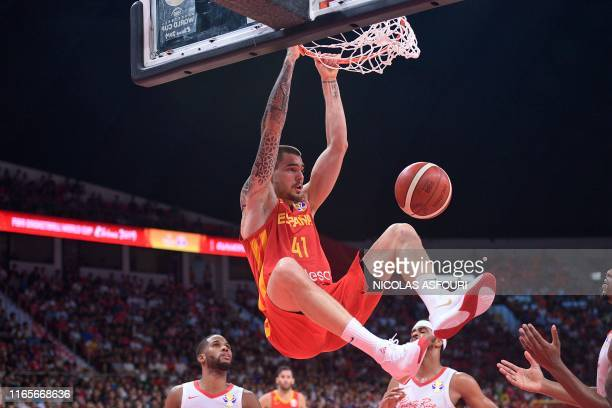 Spain's Juan Hernangomez dunks the ball during the Basketball World Cup Group C game between Puerto Rico and Spain in Guangzhou on September 2 2019