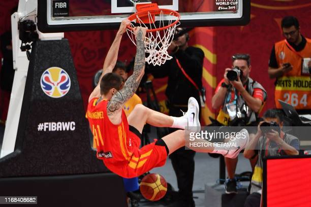 Spain's Juan Hernangomez dunks the ball during the Basketball World Cup final game between Argentina and Spain in Beijing on September 15 2019 /...