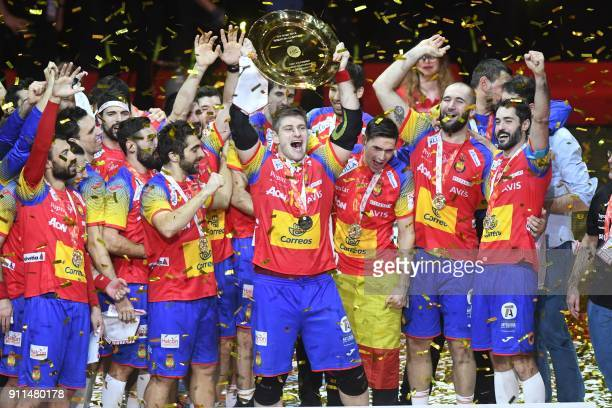 Spain's Julen Aguinagalde holds EHF European Handball Championship trophy as Spain's players celebrate during the podium ceremony after winning the...