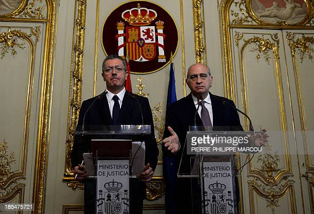 Spain's Justice Minister Alberto RuizGallardon and Spain's Interior Ministry Jorge Fernandez Diaz give a press conference in Madrid on October 21...