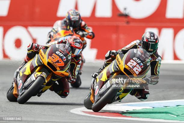 Spain's Kalex driver Augusto Fernandez and Britain's Kalex driver Sam Lowes steer their motorbikes during the Moto2 race at the TT circuit of Assen...