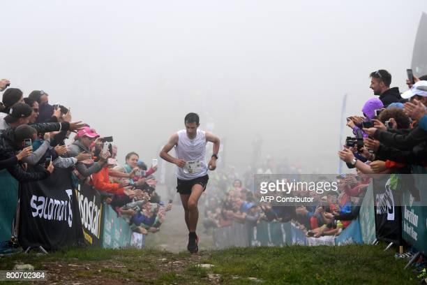 Spain's Kilian Jornet Burgada crosses the finish line to win the 15th edition of the Marathon of MontBlanc on June 25 in Chamonix The Marathon of...