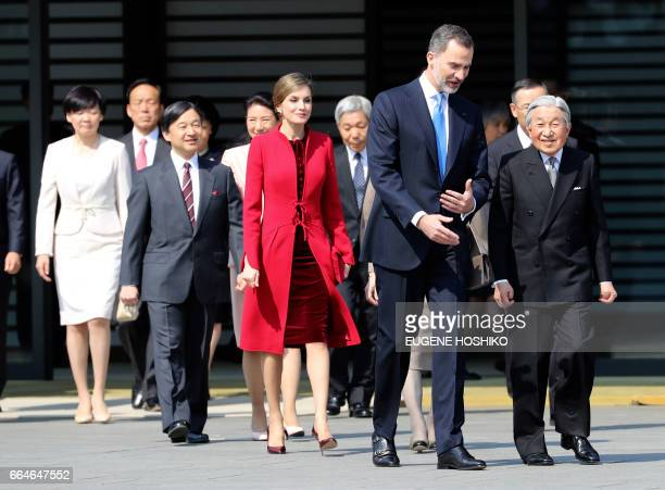 Spain's King Felipe front left and Queen Letizia in red coat are escorted by Japanese Emperor Akihito right during the welcoming ceremony at the...