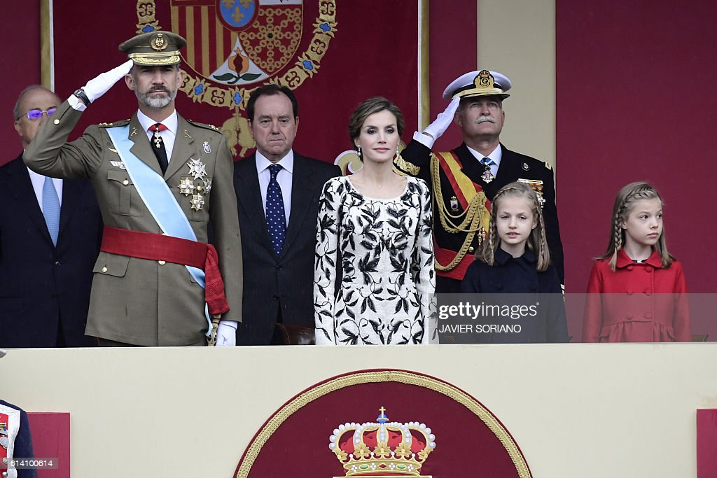 Spain's King Felipe IV, Spain's Queen Letizia, Spain's princess Sofia, and princess Leonor watch troops march during the Spanish National Day military parade in Madrid on October 12, 2016. / AFP / JAVIER