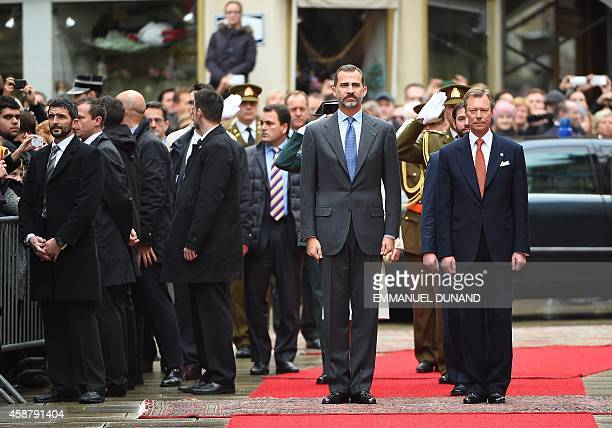 Spain's King Felipe VI and Grand Duke Henri of Luxembourg listen to national anthems during an official welcoming ceremony at the GrandDucal Palace...