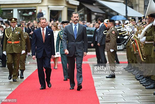 Spain's King Felipe VI and Grand Duke Henri of Luxembourg review a guard of honour during an official welcoming ceremony at the Grand-Ducal Palace in...