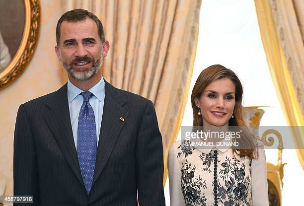 Spain's King Felipe VI and his wife Queen Letizia pose for a photo during a visit at the Grand-Ducal Palace in Luxembourg, on November 11, 2014. AFP...