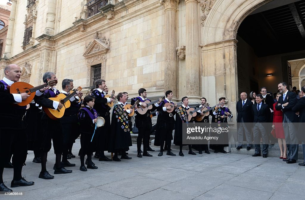 Spain's King Felipe VI (R) and Queen Letizia listen local musicians as they leave the University of Alcala de Henares after the Cervantes Prize award ceremony in Madrid, Spain, on April 23, 2015. Spanish author Juan Goytisolo was presented with the Cervantes prize from Spain's King Felipe VI on Thursday April 23, 2015. The Cervantes Prize is awarded annually to honour the lifetime achievement of an outstanding writer in the Spanish language.