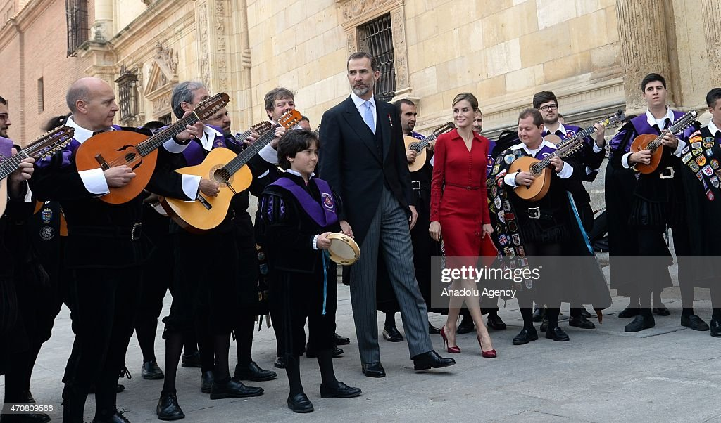 Spain's King Felipe VI (Center L) and Queen Letizia listen local musicians as they leave the University of Alcala de Henares after the Cervantes Prize award ceremony in Madrid, Spain, on April 23, 2015. Spanish author Juan Goytisolo was presented with the Cervantes prize from Spain's King Felipe VI on Thursday April 23, 2015. The Cervantes Prize is awarded annually to honour the lifetime achievement of an outstanding writer in the Spanish language.
