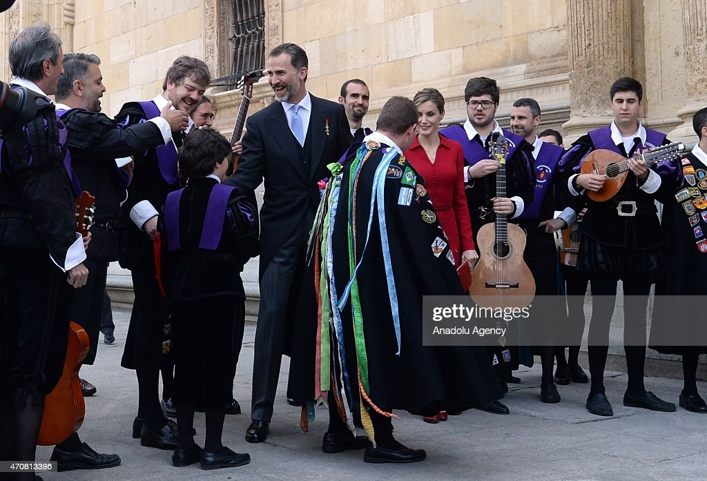 Spain's King Felipe VI (C) and Queen Letizia listen local musicians as they leave the University of Alcala de Henares after the Cervantes Prize award ceremony in Madrid, Spain, on April 23, 2015. Spanish author Juan Goytisolo was presented with the Cervantes prize from Spain's King Felipe VI on Thursday April 23, 2015. The Cervantes Prize is awarded annually to honour the lifetime achievement of an outstanding writer in the Spanish language.