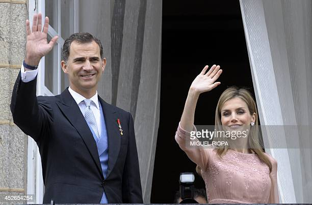 Spain's King Felipe VI and Queen Letizia salutes people from the balcony of the Raxoi Palace on the Obradoiro Square in Santiago de Compostela on...