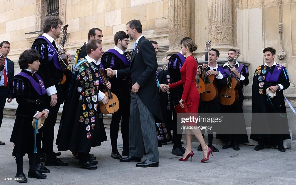 Spain's King Felipe VI (Center L) and Queen Letizia shake hands with local musicians as they leave the University of Alcala de Henares after the Cervantes Prize award ceremony in Madrid, Spain, on April 23, 2015. Spanish author Juan Goytisolo was presented with the Cervantes prize from Spain's King Felipe VI on Thursday April 23, 2015. The Cervantes Prize is awarded annually to honour the lifetime achievement of an outstanding writer in the Spanish language.