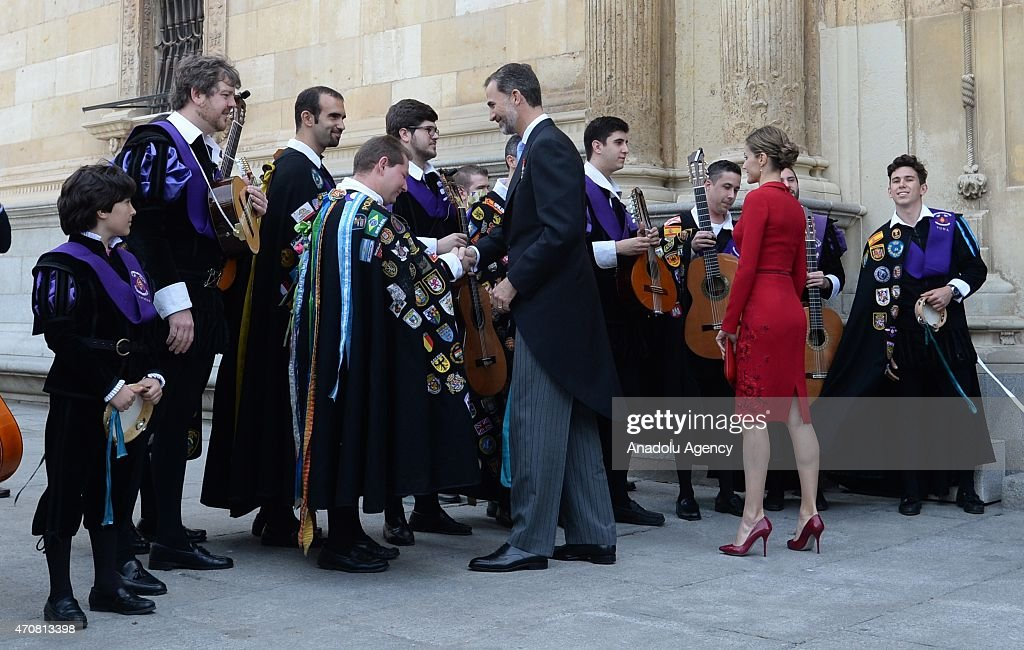 Spain's King Felipe VI (C) and Queen Letizia shake hands with local musicians as they leave the University of Alcala de Henares after the Cervantes Prize award ceremony in Madrid, Spain, on April 23, 2015. Spanish author Juan Goytisolo was presented with the Cervantes prize from Spain's King Felipe VI on Thursday April 23, 2015. The Cervantes Prize is awarded annually to honour the lifetime achievement of an outstanding writer in the Spanish language.