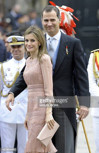 Spain's King Felipe VI and Queen Letizia walk on the Obradoiro Square in Santiago de Compostela on July 25 2014 after attending the religious...
