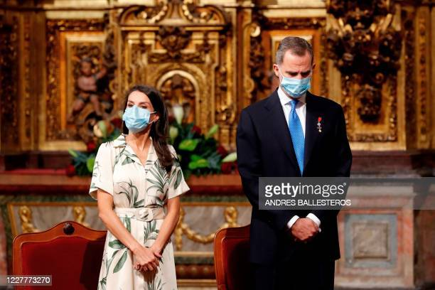 Spain's King Felipe VI and Queen Letizia wearing face masks attend a mass to mark the Day of Galicia at the church of San Martino Pinario in Santiago...